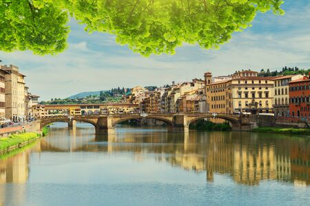trinita: Ponte Santa Trinita bridge and Ponte Vecchio bridge over the Arno River at summer, Florence, Italy