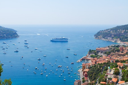villefranche sur mer: colorful coast and turquiose water with boats and ships, cote dAzur, France