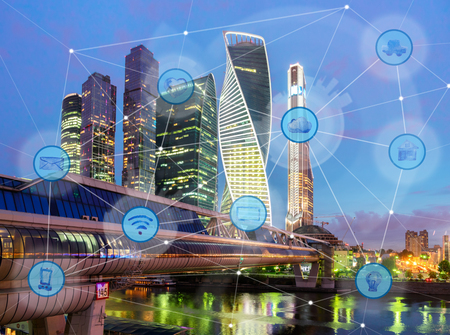 night city and wireless communication network, IoT Internet of Things and ICT Information Communication Technology concept Archivio Fotografico