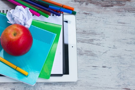 haversack: Red apple with school supplies on white wooden table Stock Photo