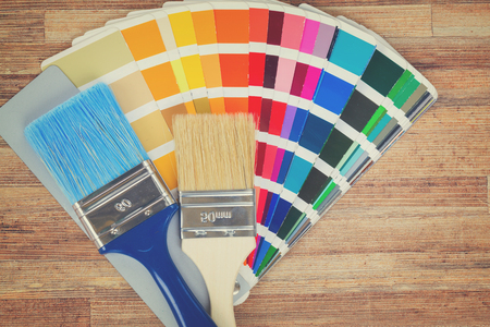 Color palette guide and brushes on wooden background, retro toned Stock Photo