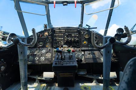 avionics: Vintage airplane dashboard, shallow focus on leverers