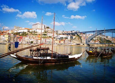 rabelo: traditional port wine boats and old towt of Porto, Portugal, retro toned Stock Photo