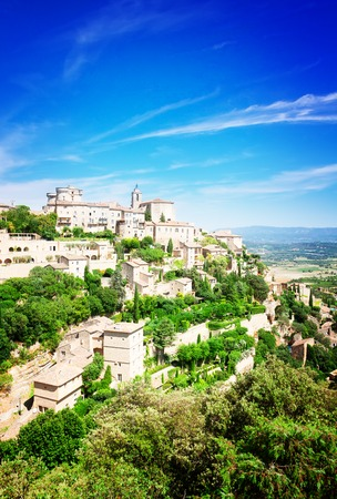 Gordes, old town fortress of Provence at summer day, France, toned Stock Photo