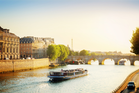 Pont Neuf and Seine river with tour boat at sunny summer sunset, Paris, France, toned Stock Photo