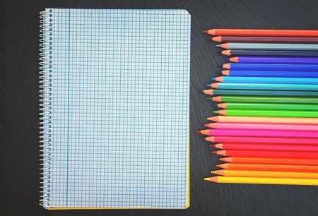 ruled: Back to school pencils rainbow and ruled notebook, retro toned Stock Photo