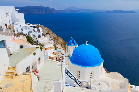 view of caldera with blue church dome and belltower, Oia, Santorini Stock Photo