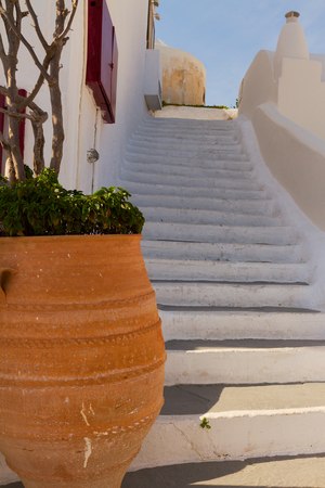 cycladic: steep step and greek vases , beautiful details of Santorini island, Greece Stock Photo