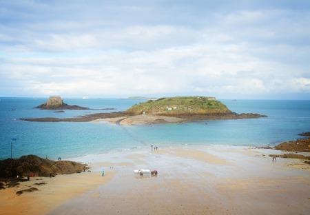 st malo: tidal islands of Saint Malo in high tide, France retro toned