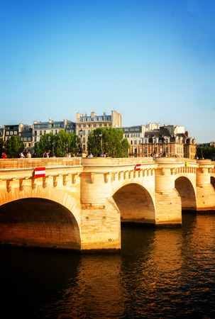 Pont Neuf and SEine river at sunny summer day, Paris, France toned