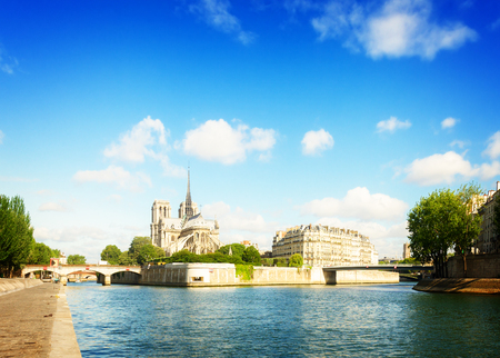 Notre Dame cathedral church, Site island and embankment of Seine at summer day, Paris, France, retro toned