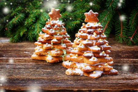 two gingerbread christmas tree with evergreen twing, retro toned