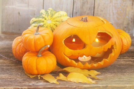 orange halloween carved pumpkin on wooden table Stock Photo