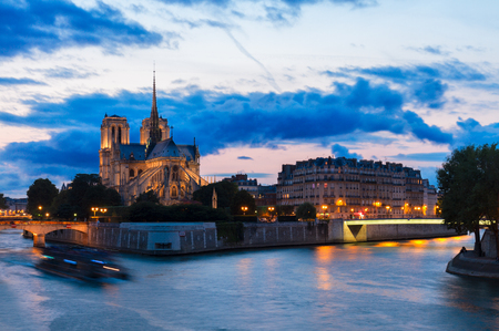 Notre Dame cathedral church and Cite island at sunset, Paris, France, toned Stock Photo