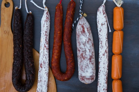 cured: Cured meat and sausages hanging a rack