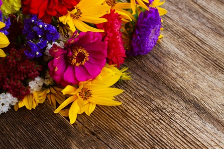 Bright fall posy on wooden background with copy space