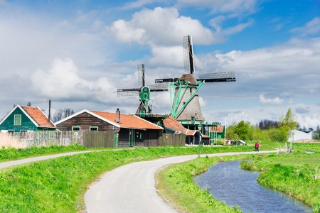 traditional Dutch rural scenery with windmill of Zaanse Schans at summer day, Netherlands