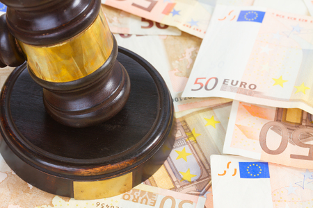 swindle: Wooden Law Gavel and Euro Money close up