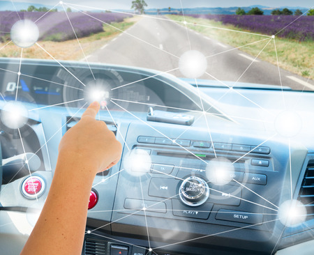 Self-driving car concept - someones hand programming modern car Stock Photo