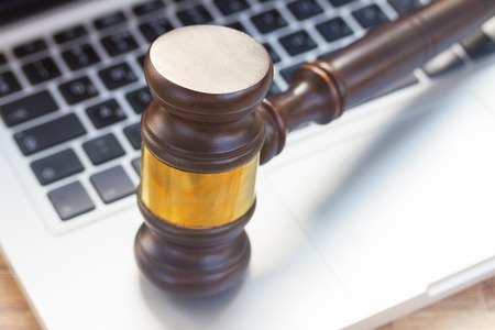 judgement: Wooden law gawel on laptop keyboard, judgement concept Stock Photo