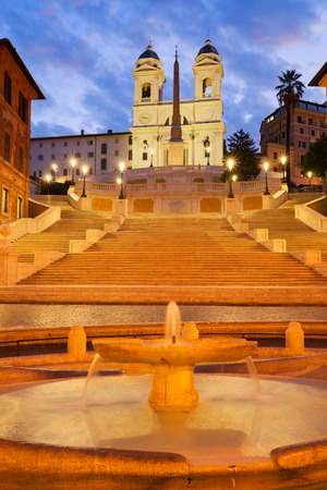 Spanish Steps with boat fountain illuminated at night, Rome, Italy