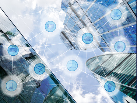 modern city and wireless communication network, IoT Internet of Things and ICT Information Communication Technology concept Stock Photo