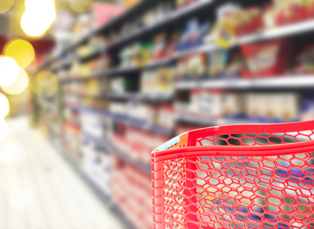 shelfs: abstract supermarket red cart and shelfs blured background Stock Photo