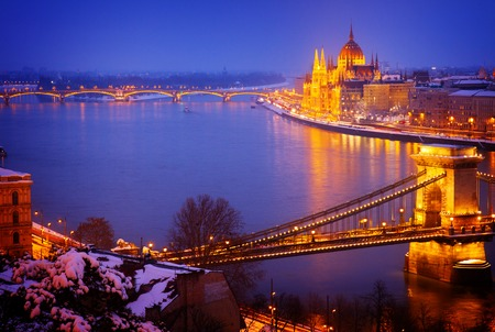 cityscape of Budapest with Danibe river and pairlament at night Hungary, retro toned Stock Photo