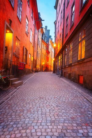 Gamla Stan narrow street illuminated at night, Stockholm, Sweden, toned