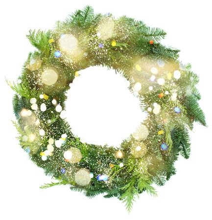 evergreen wreaths: green christmas wreath with bokeh lights isolated on white background