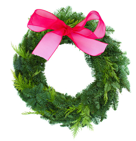 pine wreaths: green christmas wreath with red bow isolated on white background