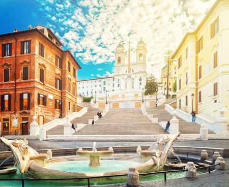 famous Spanish Steps with fountain with sunshine, Rome, Italy