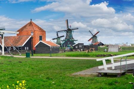traditional Dutch rural scene with windmills of Zaanse Schans, Netherlands Stock Photo