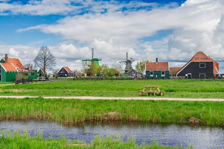 traditional Dutch rural scene with windmills of Zaanse Schans at spring day, Netherlands