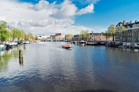 amstel: embankments of Amstel canal with traditional houses in Amsterdam, Netherlands Stock Photo