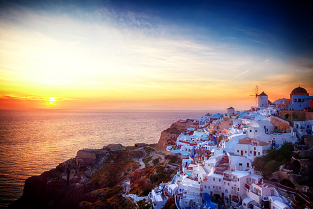famouse sunset of Oia over Aegan seal, night over Santorini island, Greece, retro toned