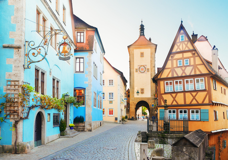 der: half-timbered houses and city tower of Rothenburg ob der Tauber, Germany Stock Photo