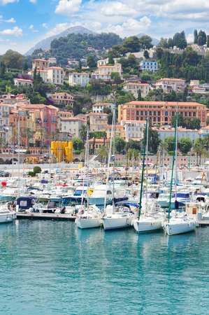 colorful houses and yachts in Menton old town harbour, France Stock Photo