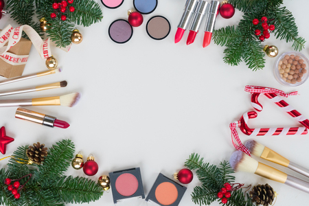 Set of Christmas make up cosmetics products frame with copy space Stock Photo