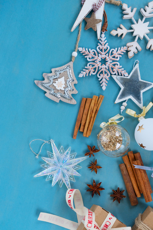Blue rustic christmas - styled christmas boder flat lay style with copy space on blue wooden background