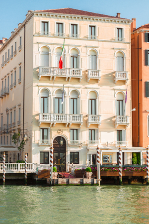 canal house: colorful traitional Venice house palazzio over water of canal, Italy Stock Photo
