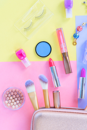 Colorful make up products with pursue pop art flat lay scene 版權商用圖片