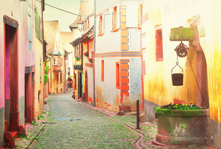 street of Riquewihr, beautiful town of Alsace, France, toned Stock Photo