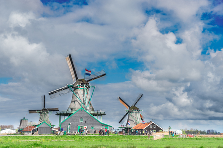 traditional Dutch scenery with windmill of Zaanse Schans with dramatic cloud sky, Netherlands