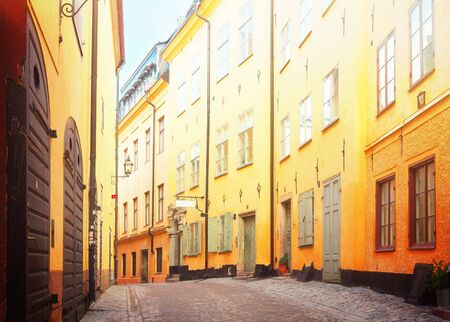 view of old town street in Stockholm at sunny day, Sweden, retro toned