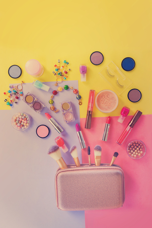 applicator: Colorful make up products with pursue pop art flat lay scene, retro toned Stock Photo