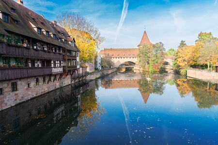 Old town of Nuremberg with half-timbered houses and bridge over Pegnitz river, Germany