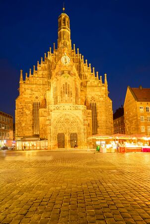 Old town with Nuremberg cathedral church illuminated at night, Germany Stock Photo