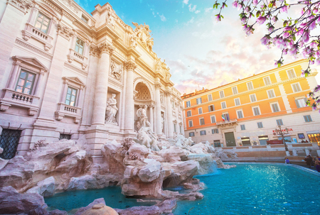 restored Fountain di Trevi in Rome in sunrise light with sunshine at spring day, Italy Stock Photo