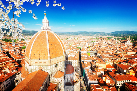 old town roofs with cathedral church Santa Maria del Fiore at spring day, Florence, Italy